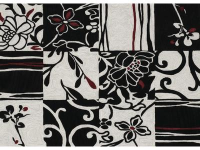 "This 5' X  7'9"" area rug is made of easy to mai..."