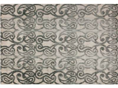 Machine woven 100% polypropylene rug has a low ...
